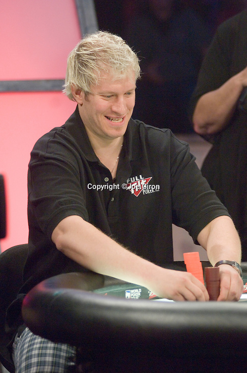 Greg Mueller prays for some good cards, when he sees that he does, he goes all in and doubles up through Mike Simon.