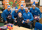 St Johnstone players took some festive cheer to Fairview School in Perth gving out selection boxes and gifts to the pupils…The players from left, Paul Paton, Zander Clark, Keith Watson, Alan Mannus and Joe Shaughnessy pictured with Ben a secondary school pupil who is massive St Johnstone fan who goes to games with his father<br />Picture by Graeme Hart.<br />Copyright Perthshire Picture Agency<br />Tel: 01738 623350  Mobile: 07990 594431