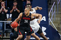 Washington, DC - March 10, 2020: Northeastern Huskies guard Maxime Boursiquot (14) spins towards the basket during the CAA championship game between Hofstra and Northeastern at  Entertainment and Sports Arena in Washington, DC.   (Photo by Elliott Brown/Media Images International)
