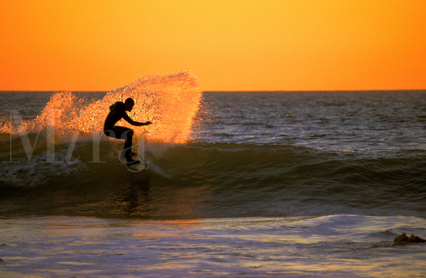Surfing at Sunset.  Huntington Beach, CA.
