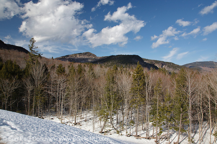 Mountain range from a sandpit along the Kancamagus Highway during the winter months in the White Mountains, New Hampshire USA. This area was part of the Swift River Railroad, which was an logging railroad in operation from 1906 - 1916.