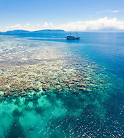 aerial view of coral reef and liveaboard, Raja Ampat Islands, West Papua, Indonesia, Pacific Ocean