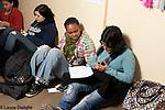 High school students studying in corridor between classes.