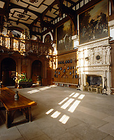 The Great Hall at Longleat features a Mannerist chimneypiece and a 16th century beamed ceiling. Equestrian paintings by John Wootton line the walls