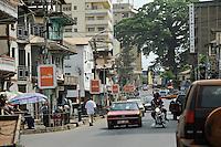 SIERRA LEONE, Freetown, city centre with Kapok or cotton tree and shopping street / Stadtzentrum mit Kapok Baum oder Wollbaum