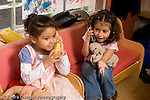 Preschool Headstart 3-5 year olds pretend play two girls in dressup clothes talking on telephones horizontal
