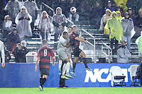 CARY, NC - DECEMBER 13: Logan Panchot #22 of Stanford University and Will Sands #14 of Georgetown University knock heads while challenging for a header with Derek Dodson #9 of Georgetown University during a game between Stanford and Georgetown at Sahlen's Stadium at WakeMed Soccer Park on December 13, 2019 in Cary, North Carolina.