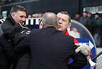 Ayr goalie coach Andy Goram whispering into Ally McCoist's ear at kick-off