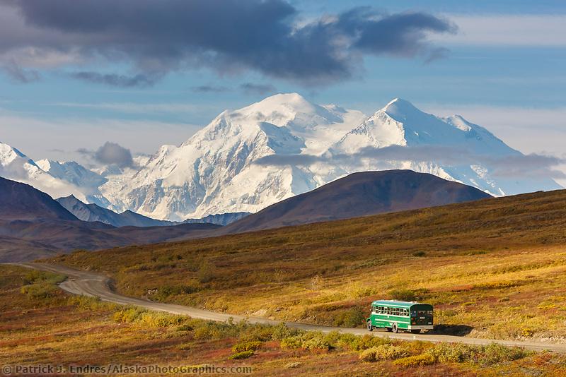 The north and south summits of Denali are visible from Highway pass as a tour bus travels along the Denali Park road, Denali National Park, Alaska.