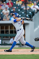 Mikie Mahtook (7) of the Durham Bulls follows through on his swing against the Charlotte Knights at BB&T BallPark on July 22, 2015 in Charlotte, North Carolina.  The Knights defeated the Bulls 6-4.  (Brian Westerholt/Four Seam Images)
