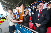 Thursday 14th March 2019 | 2019 Boys High School Final<br /> <br /> MCB captain Kevin McNaboe receives the famous trophy from the Ulster Branch President's wife Heather Elliott after his side Won Ulster Schools Cup Final between MCB and CCB at Kingspan Stadium, Ravenhill Park, Belfast , Northern Ireland. Photo by John Dickson / DICKSONDIGITAL