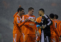 Pictured L-R: Goal scorers Danny Graham and Gylfi Sigurdsson of Swansea with goalkeeper Michel Vorm after the end of the game. Saturday, 04 February 2012<br /> Re: Premier League football, West Bromwich Albion v Swansea City FC v at the Hawthorns Stadium, Birmingham, West Midlands.