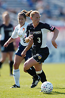 Christie Pearce of the New York Power looks up field while being chased by Shannon MacMillan of the San Diego Spirit during their May 25th game at Mitchel Athletic Complex. The Power won 2-1.