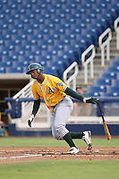 Miguel Mercedes (15) of the AZL Athletics bats during a game against the AZL Brewers at Maryvale Baseball Park on June 30, 2015 in Phoenix, Arizona. Brewers defeated Athletics, 4-2. (Larry Goren/Four Seam Images)