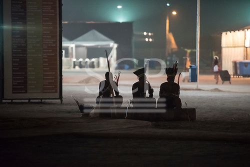 Three indigenous participants sit peacefully at the end of the day at the first ever International Indigenous Games, in the city of Palmas, Tocantins State, Brazil. The games will start officially with an opening ceremony on Friday the 23rd October. Photo © Sue Cunningham, pictures@scphotographic.com 21st October 2015