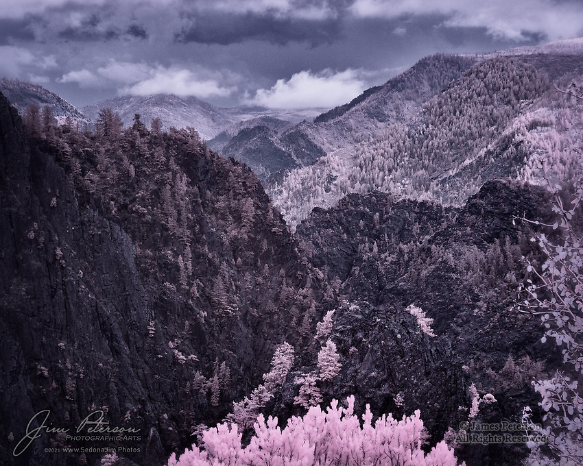 Black Canyon Interlude #1 (Infrared).  On one of the days we were in Colorado, the clouds were hanging so low that photography in the mountains wasn't possible.  The silver lining was that we were instead able to take a detour over to the Black Canyon of The Gunnison, a National Park east of Montrose.  The storm clouds there were right overhead, sometimes dropping into the canyon.  My infrared camera fell in love with everything it saw there.<br /> <br /> Tech info: Nikon D3200 camera (modified for infrared with 590nm filter) with Nikon 18-140mm lens at 100mm, 1/320 sec. at f11, ISO 200.<br /> <br /> Image ©2021 James D. Peterson