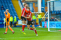 Barnsley's midfielder Harvey Barnes (15) and Barnsley's defender Jason McCarthy (2) celebrate the equaliser during the Sky Bet Championship match between Sheff Wednesday and Barnsley at Hillsborough, Sheffield, England on 28 October 2017. Photo by Stephen Buckley / PRiME Media Images.