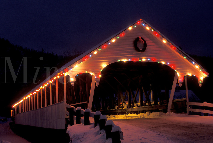 covered bridge, NH, New Hampshire, Stark, Christmas lights decorate the covered bridge in Stark at night in winter.