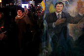 """Kiev, Ukraine.December 26, 2004..Supporters of opposition candidate Viktor Yushchenko rally to his side as election polls show him in a strong lead just hours after the polling stations are closed. ..The first round of voting was considered fraudulent when the ruling president Viktor Yahukovich won and the opposition candidate Viktor Yushchenko lost. ..Several hundred thousand Ukrainians took to the streets of Kiev and held daily rallies on Maidan Independence Square. The protests lasted nearly a month before the first vote was declared invalid and a new round of elections held on December 26, 2004. ..The demonstrations would come to be known as the """"Orange Revolution"""" after the color of the opposition party."""