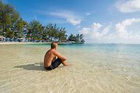 Honduras, Roatan Island, Fantasy Island Resort, Caribbean Sea. Man watching the ocean.