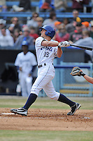 Asheville Tourists second baseman Michael Benjamin #18 swings at a pitch during a game against the  Delmarva Shorebirds at McCormick Field on April 6, 2014 in Asheville, North Carolina. The Shorebirds defeated the Tourists 4-2. (Tony Farlow/Four Seam Images)