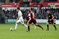 Pictured: Swansea's Ki Sung Yeung in action against Newcastle United.<br />