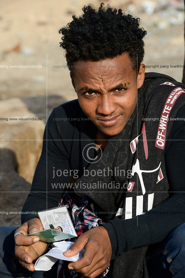 DJIBOUTI , Obock, from here ethiopian migrants try to cross bab el mandeb by boat to Yemen to go on to Saudi Arabia or Europe, ethiopian refugees from Tigray waiting outside the town for the smugglers, orthodox christians with cross scar on the forehead / DSCHIBUTI, Obock, Meerenge Bab el Mandeb, mit Hilfe von Schleppern aethiopische Migranten versuchen hier nach Jemen ueberzusetzen, um weiter nach Saudi Arabien oder Europa zu gelangen, aethiopische Fluechtlinge aus Tigray warten ausserhalb der Stadt auf die Schmuggler, orthodoxe Christen mit auf der Stirn in die Haut eingeritztem Kreuz