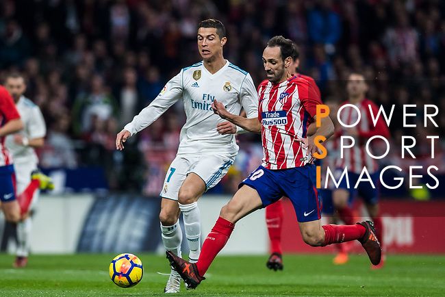 Cristiano Ronaldo of Real Madrid competes for the ball with Juan Francisco Torres Belen, Juanfran, of Atletico de Madrid during the La Liga 2017-18 match between Atletico de Madrid and Real Madrid at Wanda Metropolitano  on November 18 2017 in Madrid, Spain. Photo by Diego Gonzalez / Power Sport Images