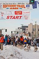 Musher Scott Janssen and Iditarider Deborah Menendez.leave the 2011 Iditarod ceremonial start line in downtown Anchorage, Alaska