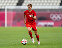 KASHIMA, JAPAN - AUGUST 2: Quinn #5 of Canada dribbles during a game between Canada and USWNT at Kashima Soccer Stadium on August 2, 2021 in Kashima, Japan.
