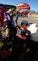 Apr. 13, 2008; Las Vegas, NV, USA: NHRA top fuel dragster driver Cory McClenathan celebrates after winning the SummitRacing.com Nationals at The Strip in Las Vegas. Mandatory Credit: Mark J. Rebilas-