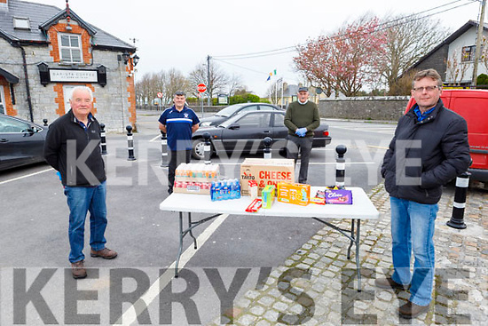 Jim O'Gorman makes a donation to the St Brendans hurling and Ardfert football clubs appeal for donations to the staff of UHK in Ardfert on Friday.<br /> L to r: Jim O'Gorman with Justin Horgan, Joe Wallace and Jermiah Clifford from the St Brendans hurling and Ardfert football clubs.