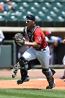 Birmingham Barons catcher Kevan Smith (32) chases down a passed ball during a game against the Tennessee Smokies on April 21, 2014 at Regions Field in Birmingham, Alabama.  Tennessee defeated Birmingham 10-5.  (Mike Janes/Four Seam Images)