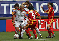 Chile, Temuco: Usa forward Lauren Fowlkes (C) goes for the ball along with  Weng Xinzhi (R) Chine´s team, during the final match on the group, Fifa U-20 Womens World Cup the at German Becker stadium in Temuco , on November 26 2008. Photo by Grosnia/ISIphotos.com
