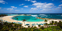 Famous, turquoise Cove Beach lagoon, with its white sand and beautiful vegetation and palm trees, located on Paradise Island, near Nassau, Bahamas