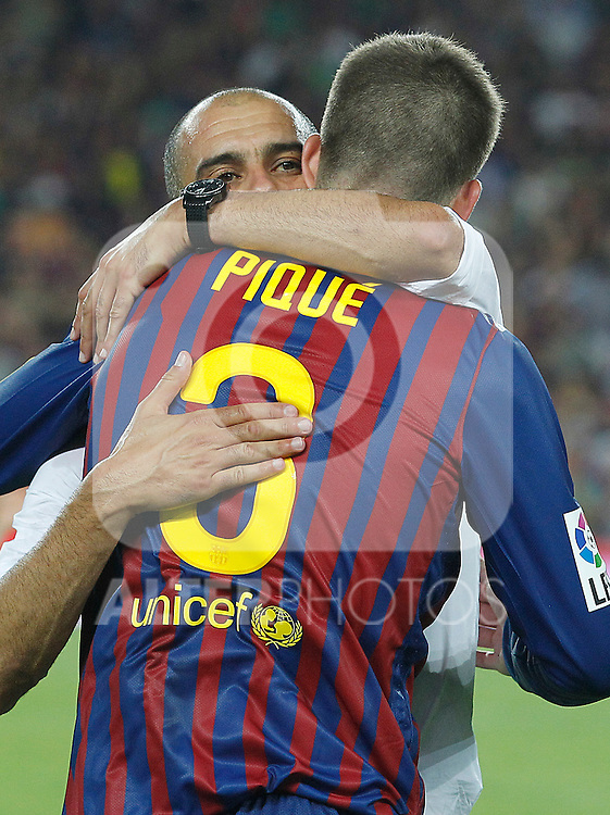 FC Barcelona's coach coach Pep Guardiola and Gerard Pique celebrates the victory during Spanish Supercup 2nd match.August 17,2011. (ALTERPHOTOS/Acero)