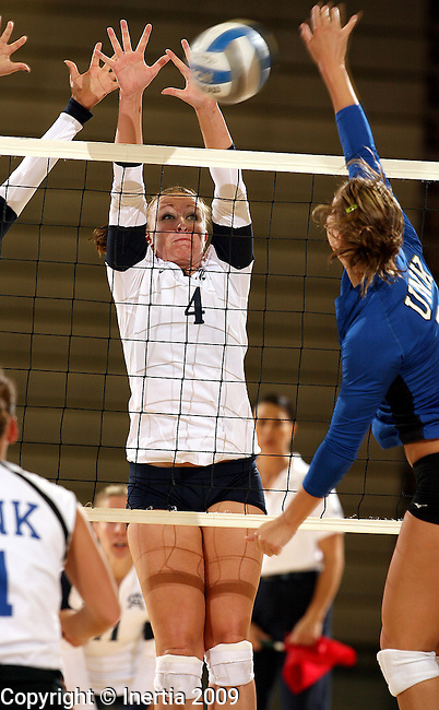 SIOUX FALLS, SD - SEPTEMBER 2:  Megan Bezdicek #4 of Augustana tries to block a kill attempt by Jeri Walkowiak #6 of Nebraska-Kearney in the second game of their match Wednesday night at the Elmen Center. (Photo by Dave Eggen/Inertia).