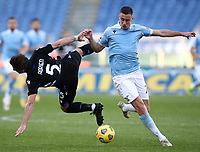 Football, Serie A: S.S. Lazio - Sampdoria, Olympic stadium, Rome, February 20, 2020. <br /> Lazio's Adam Marusic (r) in action with Sampdoria's Adrien Silva (l) during the Italian Serie A football match between S.S. Lazio and Sampdoria at Rome's Olympic stadium, Rome, on February 20, 2021.  <br /> UPDATE IMAGES PRESS/Isabella Bonotto