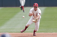 Arkansas infielder Robert Moore (1) makes a catch, Saturday, April 3, 2021 during the third inning of a baseball game at Baum-Walker Stadium in Fayetteville. Check out nwaonline.com/210404Daily/ for today's photo gallery. <br /> (NWA Democrat-Gazette/Charlie Kaijo)