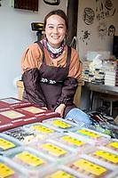 Yangzhou, Jiangsu, China.  Young Woman Selling Snacks in Dong Guan Street.