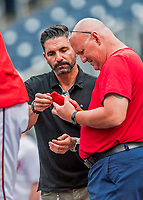 15 August 2017: MASN Broadcaster and former MLB player F.P. Santangelo shows Washington Nationals Director of Athletic Training Paul Lessard some information on an iPhone prior to a game against the Los Angeles Angels at Nationals Park in Washington, DC. The Nationals defeated the Angels 3-1 in the first game of their 2-game series. Mandatory Credit: Ed Wolfstein Photo *** RAW (NEF) Image File Available ***