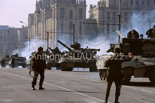 Moscow, Russia.October 5, 1993..After a day of extreme violence Russian troops and tanks take control and surround the Russia Parliament building. ..The preceding day saw Russian tanks and troops fire directly into the face of the building to dislodge hundreds of well armed anti-Yeltsin demonstrators held up inside. The demonstrators were either killed or arrested by the military. Numerous tank rounds were fired into the face of the building throughout the day with the upper floors catching fire and burning into the night..