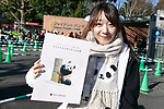 A visitor poses for a photograph after meet new giant panda cub Xiang Xiang at Tokyo's Ueno Zoo on December 19, 2017, Tokyo, Japan. The new female panda cub Xiang Xiang, born June 12, 2017, is being shown to the public for the first time. More than one thousand visitors are expected to come to see the panda on the day of her public debut. (Photo by Rodrigo Reyes Marin/AFLO)