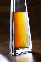 Rakija grappa type spirit flavoured with herbs backlit, Travarica, Toreta Vinarija. Detail Toreta Vinarija Winery in Smokvica village on Korcula island. Vinarija Toreta Winery, Smokvica town. Peljesac peninsula. Dalmatian Coast, Croatia, Europe.