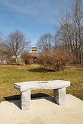 Granite bench along a walking path at Fort Foster Park in Kittery, Maine USA. This old fort is located on the coast of Maine.