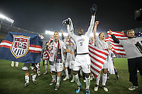 Carlos Bocanegra talks to the fans while Jozy Altidore and the USA team celebrate after a 2-2 tie with Costa Rica to put the USA in first place of CONCACAF 2010 World Cup qualifying, at RFK Stadium, in Washington DC, Wednesday, October 14, 2009.