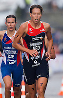 26 AUG 2012 - STOCKHOLM, SWE - Danne Boterenbrood (NED) of The Netherlands (right) leads Radka Vodickova (CZE) of Czech Republic (left) during their run leg at the 2012 ITU Mixed Relay Triathlon World Championships in Gamla Stan, Stockholm, Sweden .(PHOTO (C) 2012 NIGEL FARROW)