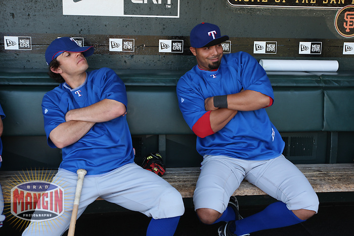 SAN FRANCISCO - JUNE 20:  Ian Kinsler and Nelson Cruz of the Texas Rangers sit in the dugout before the game against the San Francisco Giants at AT&T Park in San Francisco, California on Saturday, June 20, 2009.  The Giants defeated the Rangers 2-1.  Photo by Brad Mangin
