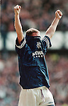 Gazza slots away goal number three from the penalty spot to seal the 1995-96 Premier League title against Aberdeen at Ibrox and pulls his Rangers shirt over his head as he punches the air in celebration