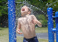 Micah Dill enjoys the cooling waters of the Belmont Park spray ground Wednesday afternoon in Charlottesville, Va. Photo/The Daily Progress/Andrew Shurtleff